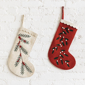 A Craftspring handmade red felt Christmas stocking with embroidered white berries and a white scalloped edge