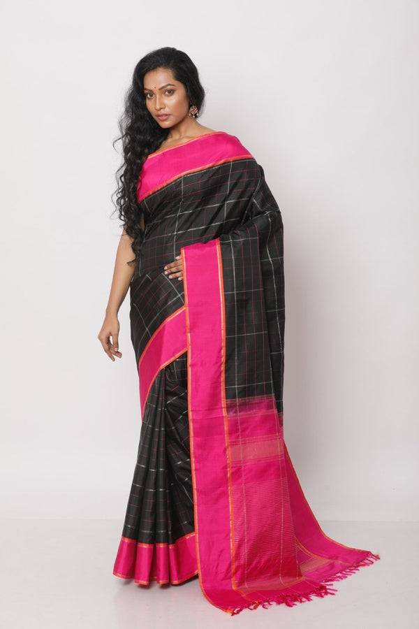 Kanjiveraam Silk in Lustrous Black with a Pink Border.