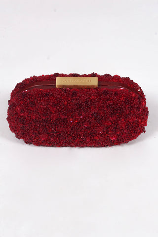 Sabyasachi red sequinned floral capsule clutch