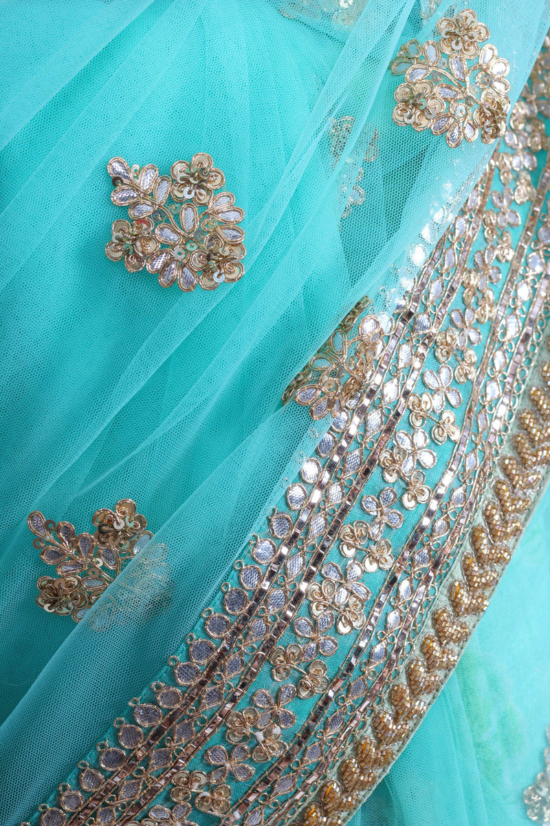 Sabyasachi turquoise tulle saree with gota embroidery