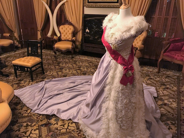 Lit Up for Her Majesty: The 'Iolani Palace's Evening Tour adorned with Royal Dresses