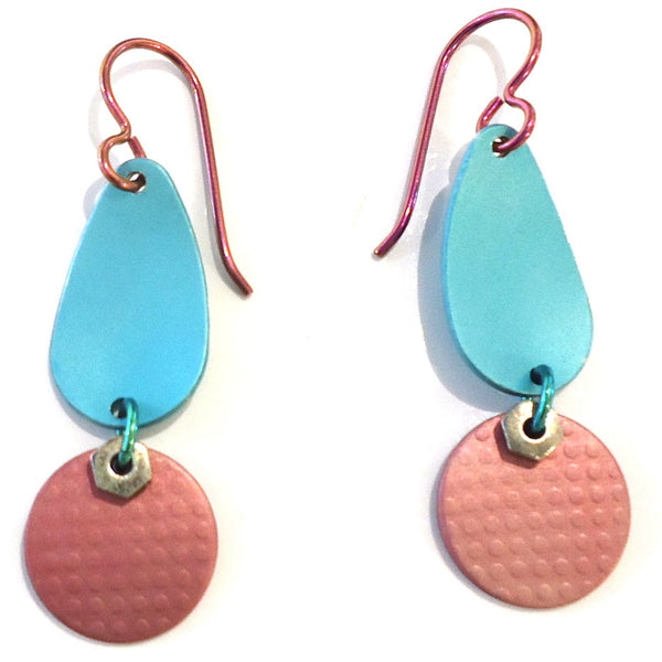 Handmade aluminum drop earrings with pink circles suspended from blue ovals