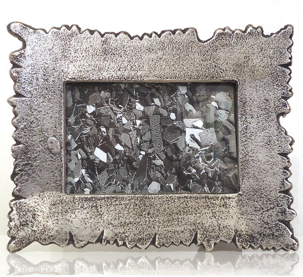 Picture frame made from recycled aluminum with irregular, free-form edges