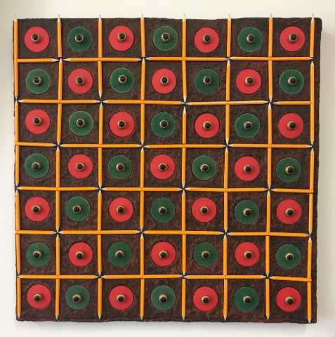 Square paper pulp, mixed-media and found object wall sculpture arranged in a checkerboard pattern of green and red circles on a dark brown background.