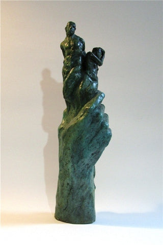 Bronze sculpture of upright hand holding three figures by Philadelphia artist Colleen O'Donnell