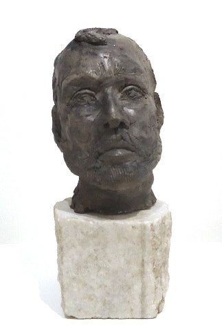 Self drying clay sculpture of a male head with graphite finish by Philadelphia artist Peggy O'Donnell