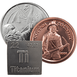 Three bullion coins of copper, silver, and titanium