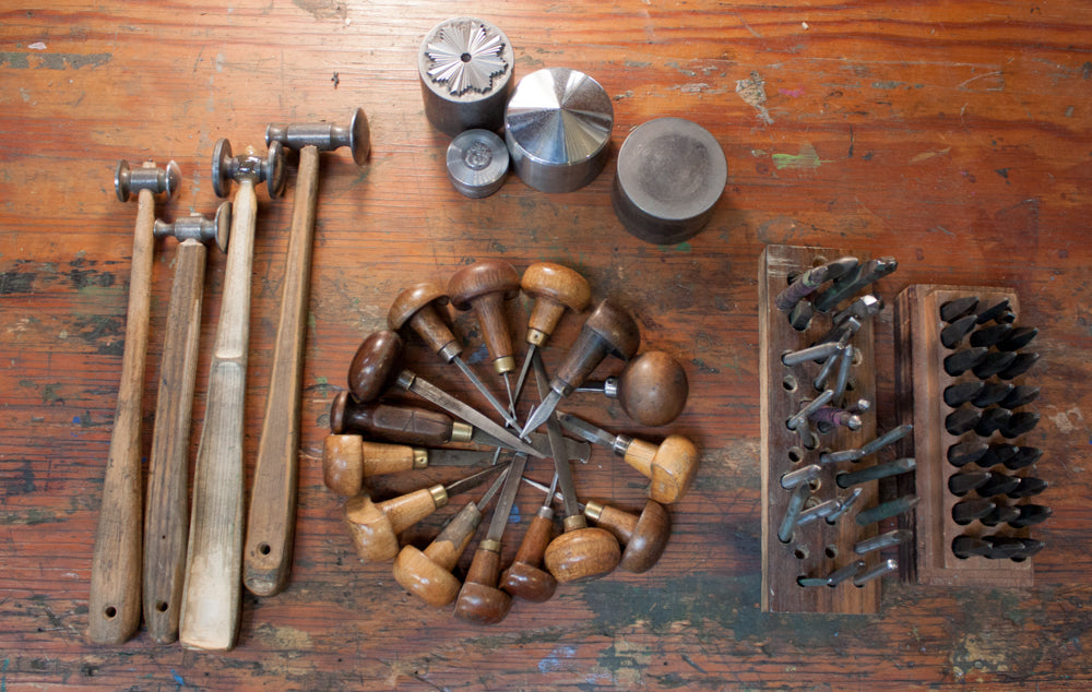 Metal engraving tools used to carve a die