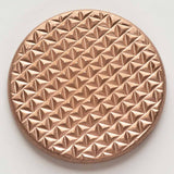 The grippy textured side of the duplex worry coin