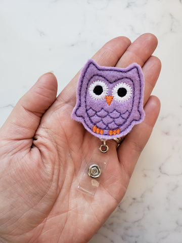 purple embroidered owl badge reel