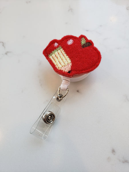 red embroidered apple teacher badge reel