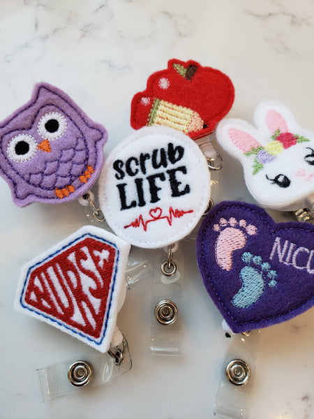 variety of nurse and teacher badge reels