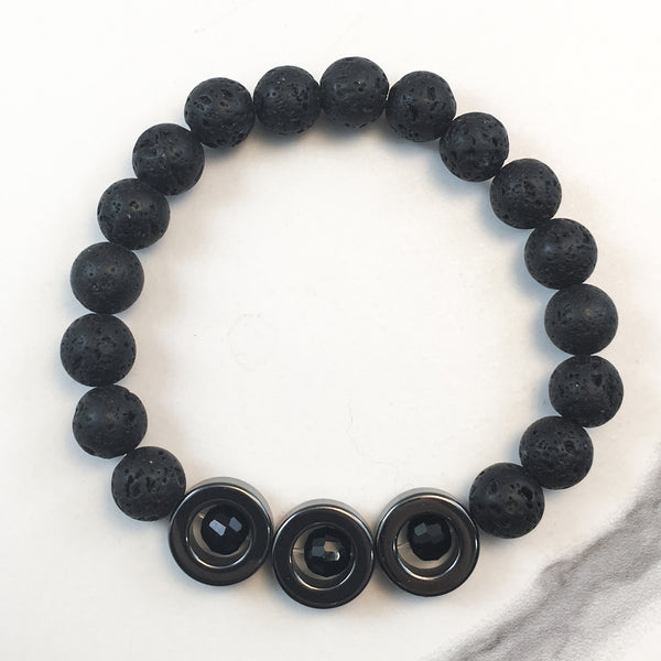Three Hematite Rings and Lava Diffuser Bracelet