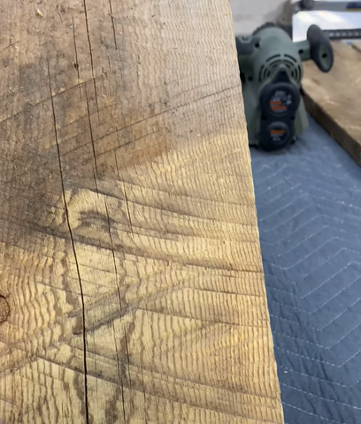 Close up of barnwood partially sanded