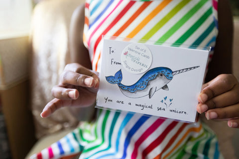 Girl holding narwhal Valentine's Day Card