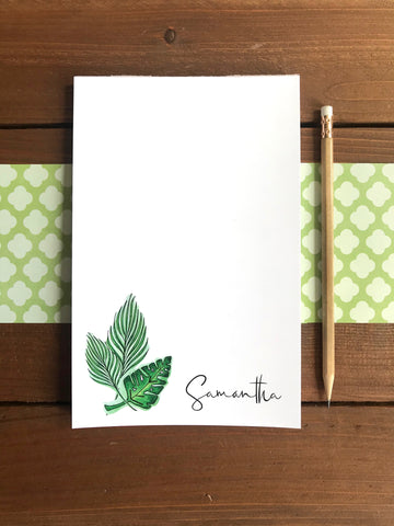 personalized tropical leave notepad on a green and wood background