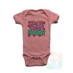 A PINK Baby Onesie with the  ' Baby onesie 'I AM A CUTIE PATOOTIE' kids funny novelty design. #8120 / New Born, 6m, 12m, 24m Sizes ' design.