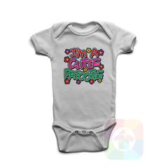 A WHITE Baby Onesie with the  ' Baby onesie 'I AM A CUTIE PATOOTIE' kids funny novelty design. #8120 / New Born, 6m, 12m, 24m Sizes ' design.