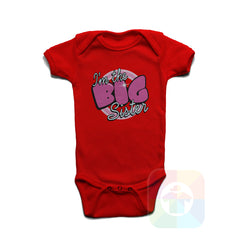 A RED Baby Onesie with the  ' Baby onesie 'I AM THE BIG SISTER' kids funny novelty design. #8133 / New Born, 6m, 12m, 24m Sizes ' design.