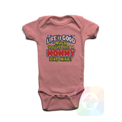A PINK Baby Onesie with the  ' Baby onesie 'LIFE IS GOOD WHEN YOU VE GOT A MOMMY LIKE MINE' kids funny novelty design. #8231 / New Born, 6m, 12m, 24m Sizes ' design.