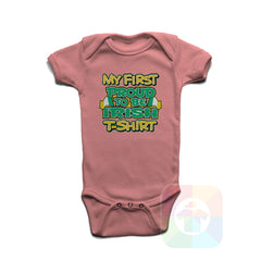 A PINK Baby Onesie with the  ' Baby onesie 'MY FIRST PROUD TO BE IRISH TSHIRT' kids funny novelty design. #8271 / New Born, 6m, 12m, 24m Sizes ' design.