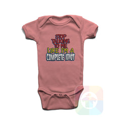 A PINK Baby Onesie with the  ' Baby onesie 'STOP TALKING TO ME LIKE A COMPLETE IDIOT' kids funny novelty design. #8341 / New Born, 6m, 12m, 24m Sizes ' design.