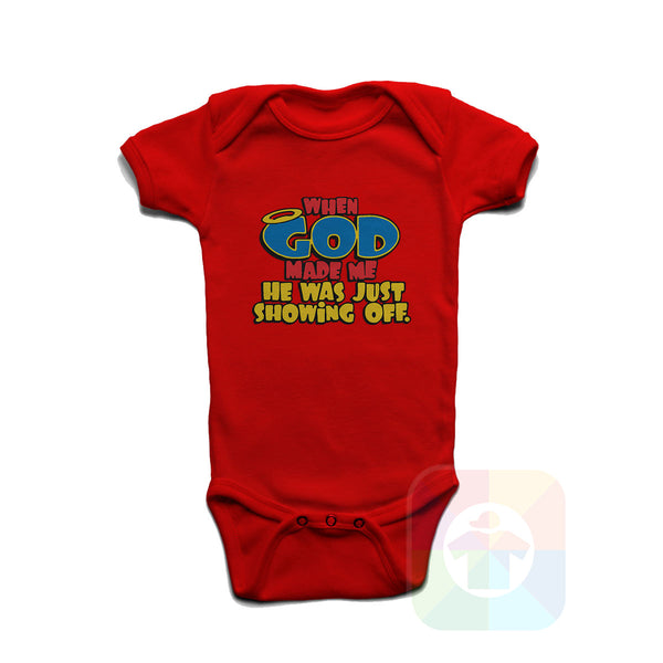 A WHITE Baby Onesie with the  ' Baby onesie 'WHEN GOD MADE ME HE WAS JUST SHOWING OFF' kids funny novelty design. #8363 / New Born, 6m, 12m, 24m Sizes ' design.