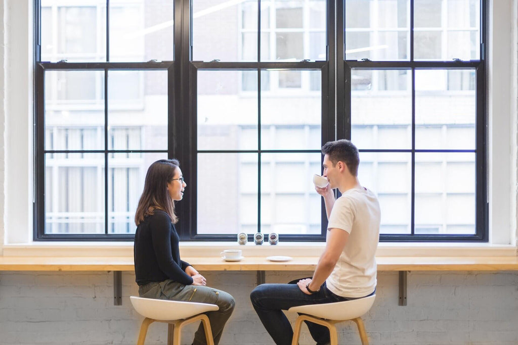 A picture of a man and women conversing, possibly practising the art of giving a compliment