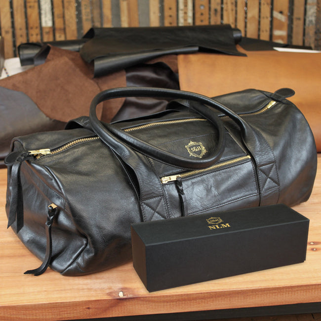 Black Leather Duffle - Swagger & Hide | Our leather luggage accessories and leather travel bags make the perfect gift for him!  All of our products are handcrafted and personalised.