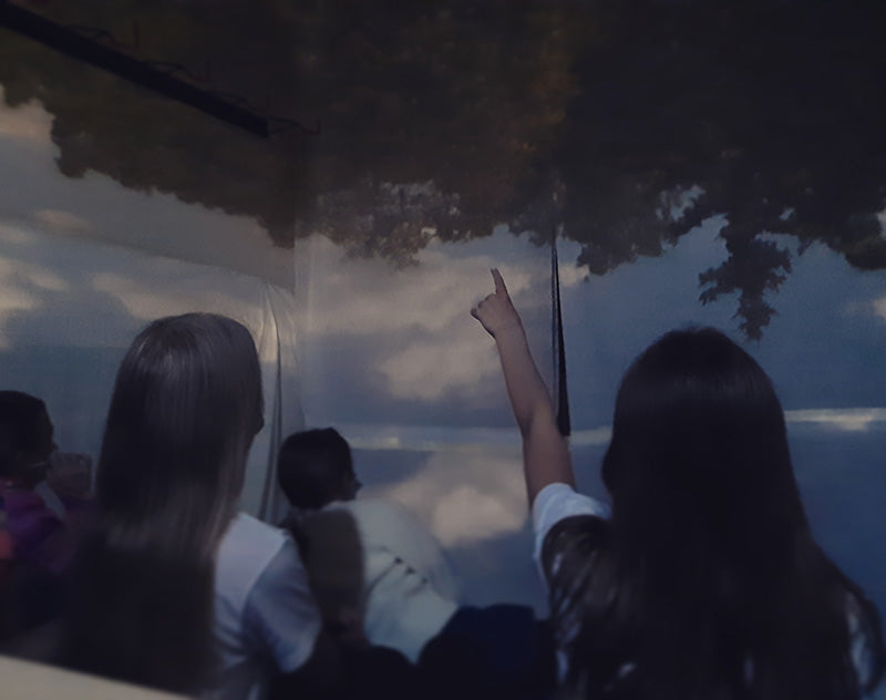 School children are amazed of the Camera Obscura effect they see on the wall