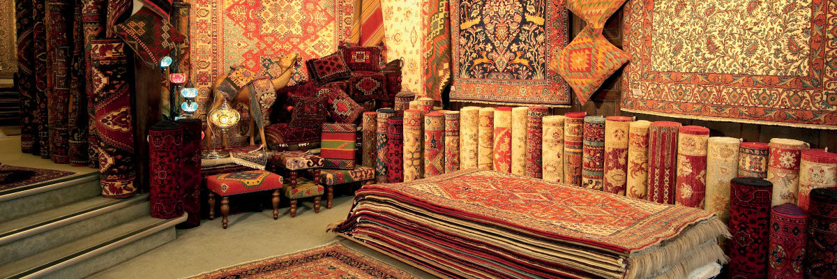 JW Jennings hand picked handmade rugs, cushions, stools