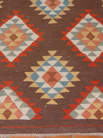 This kilim is a traditional design that has been woven by an Afghan weaver.