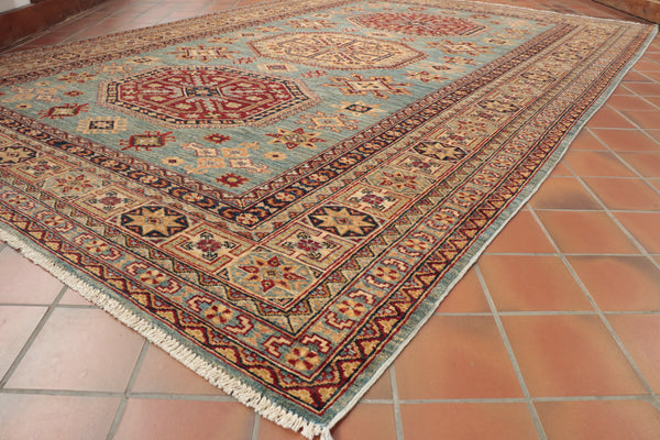 This traditional Afghan Kazak has been hand knotted using handspan wool and natural dyes.