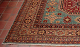Other colours in this Kazak rug are strong brick red, beige and dark blue.