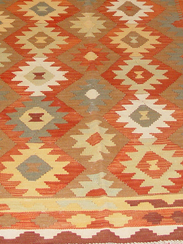 This Afghan Kilim rug is a terrific example of an old design that has been revisited many time. The background colour is warm caramel with tones of terracotta and buttermilk colours
