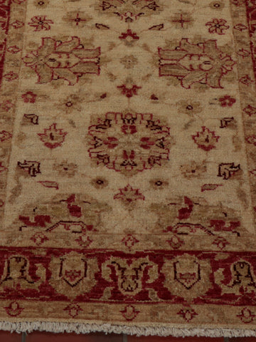 An Afghan Ziegler runner with a lovely light cream background and soft red border.