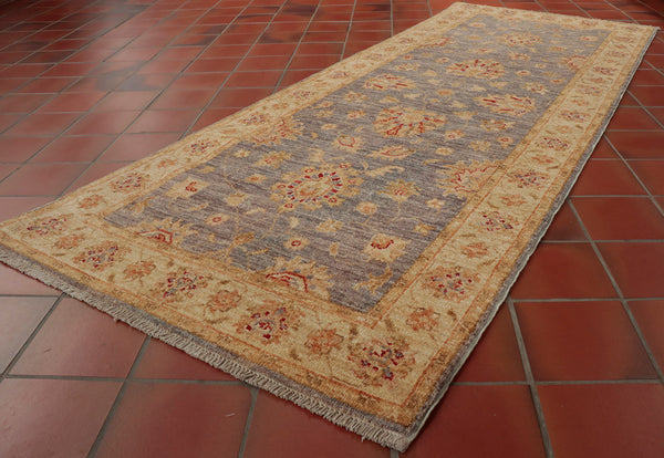 A hand made runner from northwest Afghanistan in soft mellow colours.