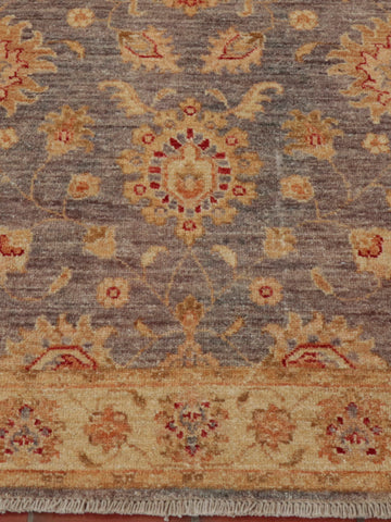 A beautiful delicate colouring has been used in this traditional runner.