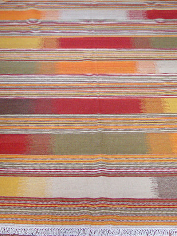 A bright lively coloured modern Indian kilim using wool on a cotton foundation.