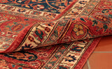A fine Afghan carpet where colourings are gentle and the design sophisticated.