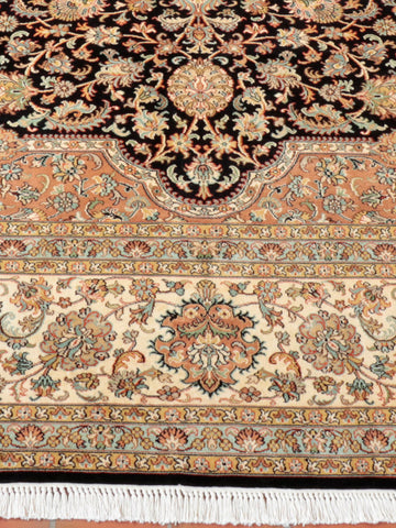 Fine Kashmir silk large carpet often taking designs from Persian carpets.