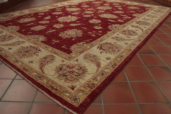 A hand knotted Fine Afghan Ziegler rug with an arts and craft look about it.