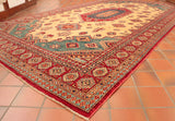 Fine Afghan Kazak with a cream background and red border.