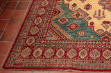 Kazak rug of long proportions in light colour.