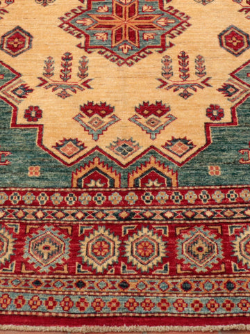 A longer than usual hand made fine Afghan Kazak rug.