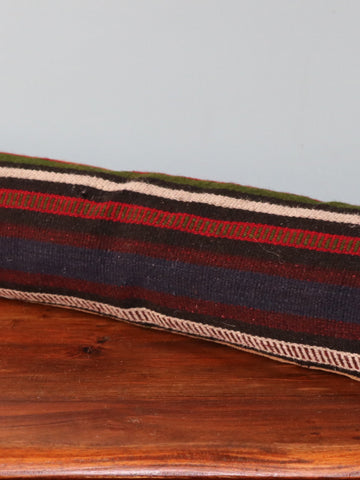 This draught excluder is made from salvaged old Turkish kilim on the front face,