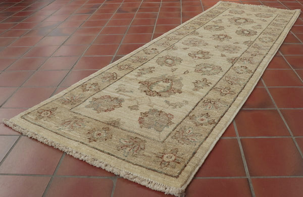 Hand made in Afghanistan this runner only uses cream, beige, brown and a tiny amount of soft blue.