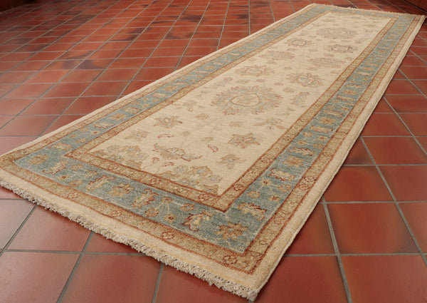 This Afghan runner may be pale in colour but the quality hand spun wool and fineness of the weave makes it hard wearing.