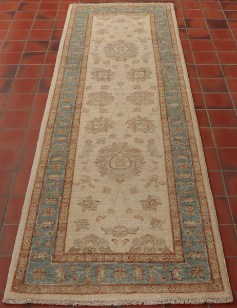 A traditional hand knotted Afghan Ziegler runner in pale colours.