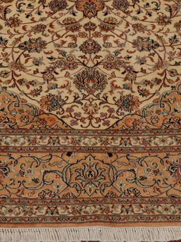 Fine Kashmir silk carpet with ivory background, apricot border and duck egg blue detail.